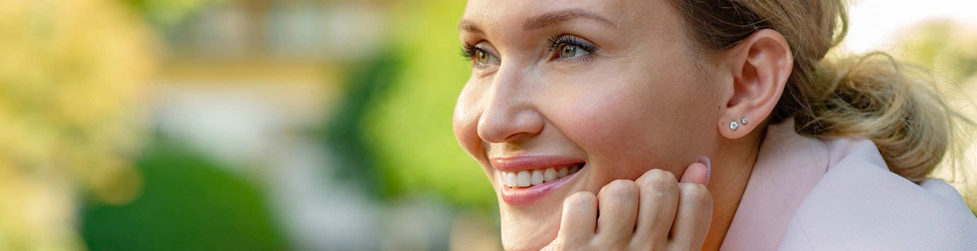 A woman is smiling after Restylane treatment