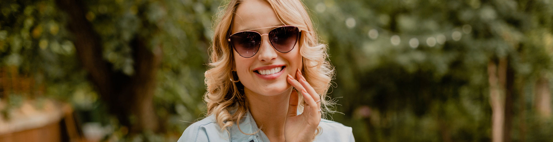 A woman is smiling after Sculptra treatments
